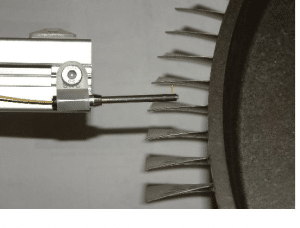 Fiber-based 3mm side-viewing probe on a robotic arm inspects blisk surfaces.