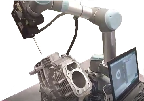 NOVACAM rotational scanner RS2 on a robotic arm inspects bores in an engine cylinder block